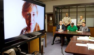 John Albert Gardner III (center, seated) lowers his head as a video presentation of Chelsea King is played during his sentencing May 14 in San Diego. Gardener, a sex offender who admitted murdering Chelsea and another teenage girl, was sentenced to life in prison without parole. (Associated Press)