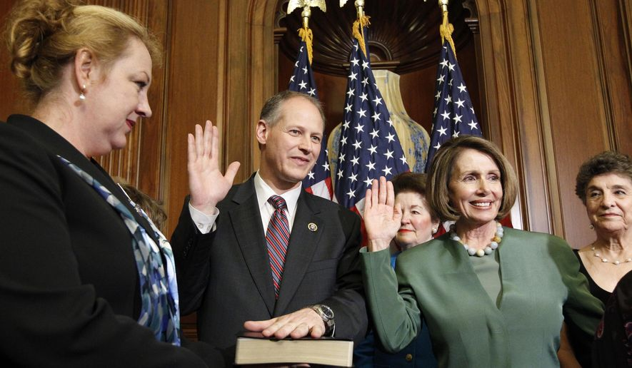 House Speaker Nancy Pelosi of Calif., second from right, administers the House oath to Rep. Mark Critz, D-Pa., during a reenactment swearing ceremony for Critz, Thursday, May 20, 2010, on Capitol Hill in Washington. Critz's wife Nancy Critz holds the Bible at left. (AP Photo/Alex Brandon)