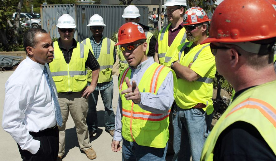 Massachusetts Gov. Deval Patrick speaks with workers prior to a news conference at the Chelsea Street Bridge construction site in Chelsea, Mass., Thursday, May 20, 2010. Massachusetts added more than 19,000 jobs last month, helping the state's unemployment rate drop to 9.2 percent from 9.3 percent the previous month, and indicating an economic recovery. The state Executive Office of Labor and Workforce Development announced Thursday that April's job gains were the largest monthly increase in 17 years. The national unemployment rate for April was 9.9 percent. (AP Photo/Elise Amendola)