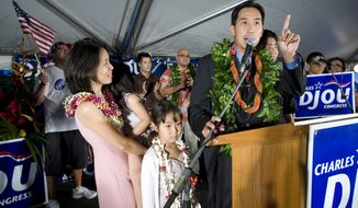 ** FILE ** Honolulu City Councilman Charles Djou, a Republican, addresses his supporters on Saturday, May 22, 2009, in Honolulu after defeating two Democrats in a special election to fill the House seat vacated by Democrat Neil Abercrombie, who resigned from Congress to run for governor. Stacey Djou (left), Mr. Djou's wife, holds their daughter Alli as daughter Tori (bottom left) and son Nick (far right) look on. (AP Photo/Eugene Tanner)