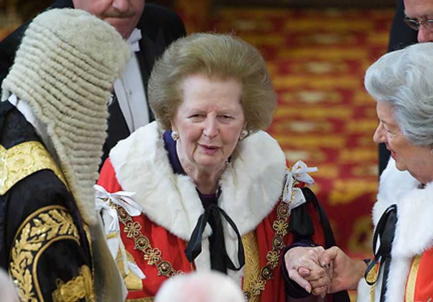 Former British Prime Minister Margaret Thatcher is assisted in the House of Lord's during the State Opening of Parliament at the Palace of Westminster,  London Tuesday May 25, 2010. Queen Elizabeth II opened Parliament Tuesday with centuries-old tradition and pageantry, laying out the new coalition government's plans to reduce Britain's ballooning deficit and restore growth. (AP Photo/Arthur Edwards, Pool)