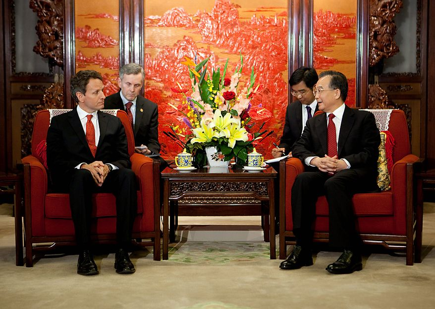 Wen Jiabao (right), China's premier, speaks with Treasury Secretary Timothy F. Geithner at a meeting during the U.S.-China Strategic and Economic Dialogue (S&ED) in Beijing on Tuesday, May 25, 2010. (Bloomberg News/Nelson Ching)