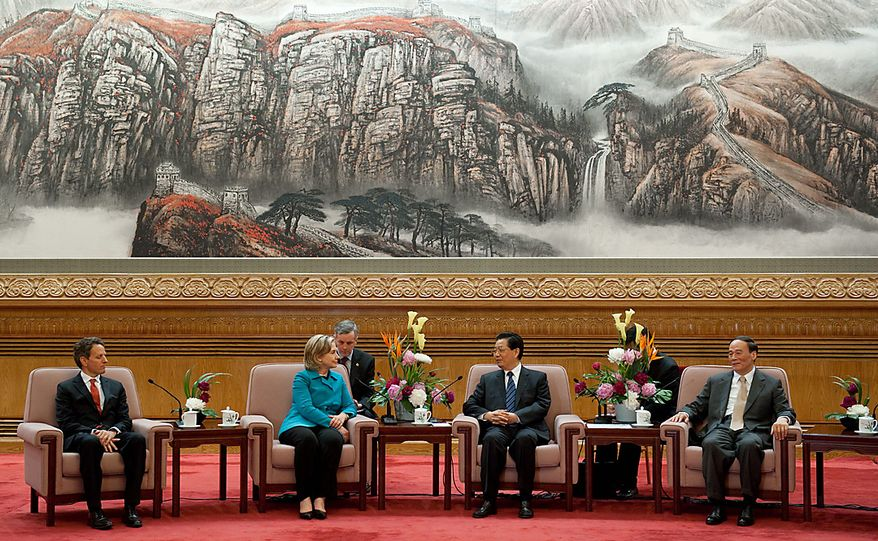 Chinese President Hu Jintao (second from right) speaks with Secretary of the Treasury Timothy F. Geithner (left), Secretary of State Hillary Rodham Clinton (second from left) and Chinese Vice Premier Wang Qishan (right) during their meeting at the Great Hall of the People in Beijing on Tuesday, May 25, 2010. (AP Photo/Saul Loeb, Pool)