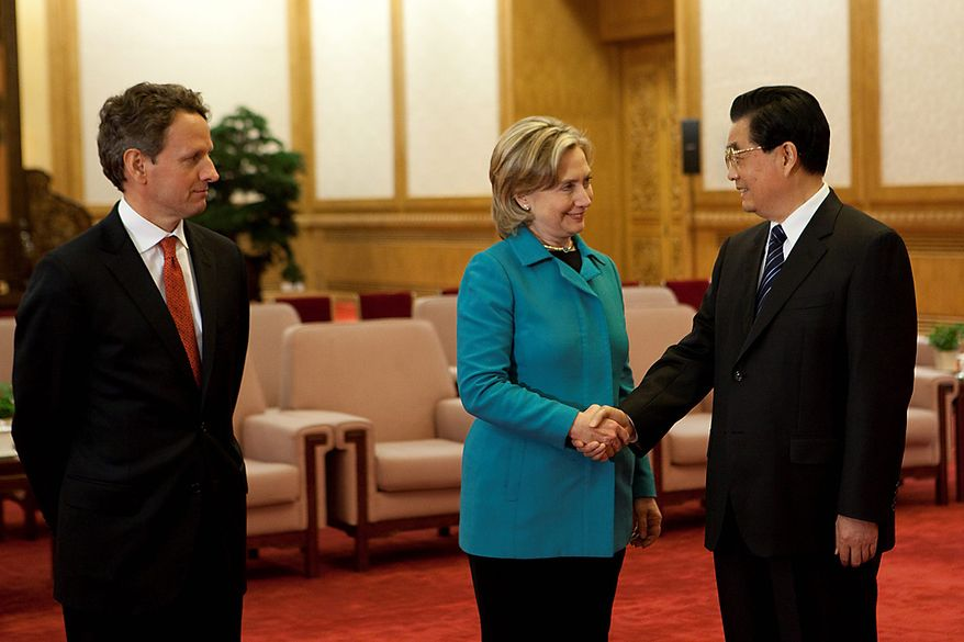 Hillary Rodham Clinton (center), U.S. secretary of state, shakes hands with Hu Jintao (right), China's president, as Timothy F. Geithner, U.S. Treasury secretary, looks on during the U.S.-China Strategic and Economic Dialogue (S&ED) in Beijing on Tuesday, May 25, 2010. China values, and is committed to preserving, stability in the northeast Asian region, Mrs. Clinton said. (Bloomberg News/Nelson Ching)
