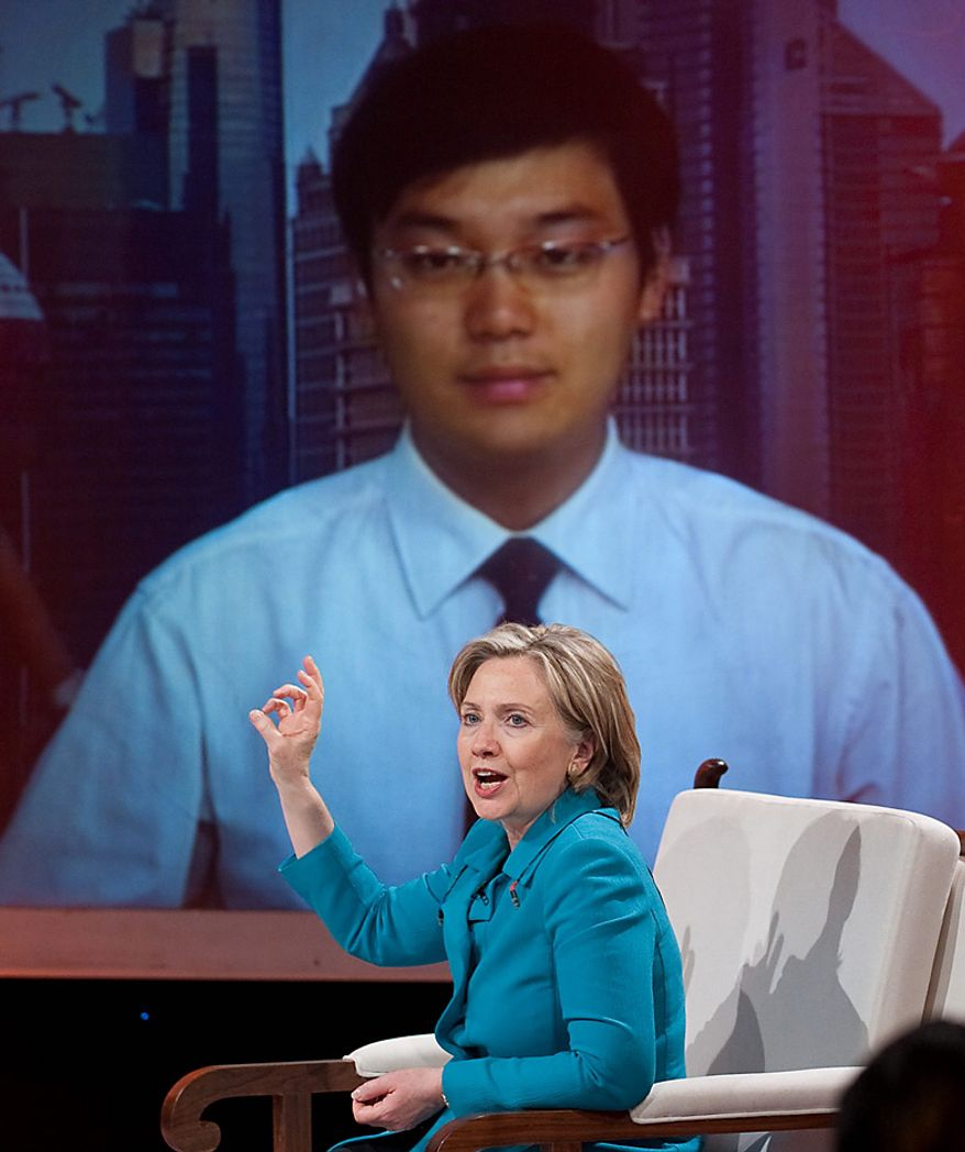 """Secretary of State Hillary Rodham Clinton responds to a question from a viewer by satellite while appearing on the show """"Dialogue"""" at CCTV studios in Beijing on Tuesday, May 25, 2010. (AP Photo/Saul Loeb, Pool)"""