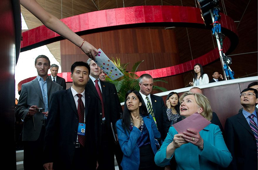 A young Chinese girl reaches out to hand Secretary of State Hillary Rodham Clinton a letter after Mrs. Clinton signed an agreement at the National Center for the Performing Arts in Beijing on Tuesday, May 25, 2010. (AP Photo/Saul LOEB, Pool)