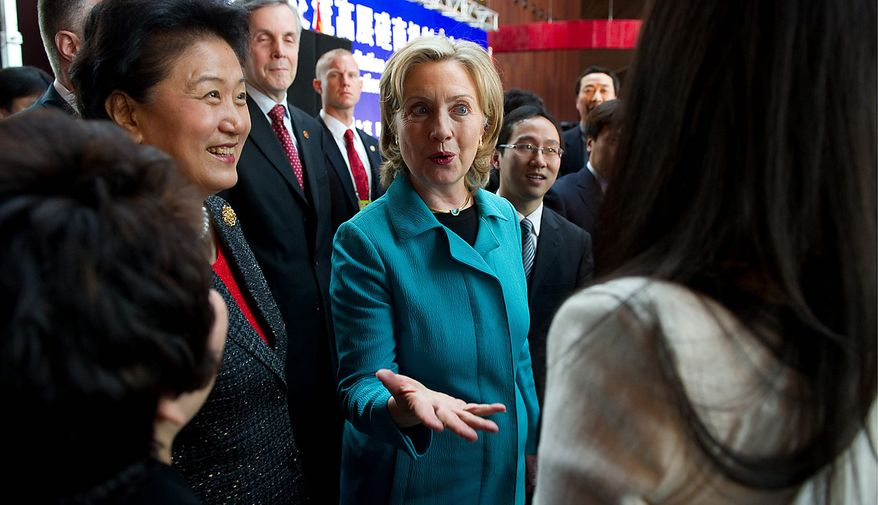 Secretary of State Hillary Rodham Clinton (center) and Chinese State Councilor Liu Yandong (left) greet guests at the National Center for the Performing Arts in Beijing on Tuesday, May 25, 2010. (AP Photo/Saul Loeb, Pool)