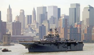 In this 2010 file photo, sailors line the deck of the USS Iwo Jima, an amphibious assault ship, as it passes the skyline of Lower Manhattan on Wednesday in New York Harbor for the start of the 23rd Fleet Week. (Associated Press) ** FILE **