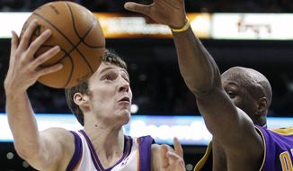 ASSOCIATED PRESS Phoenix Suns guard Goran Dragic, of Slovenia, shoots around Los Angeles Lakers forward Lamar Odom during the second half of Game 4 of the NBA basketball Western Conference finals Tuesday, May 25, 2010, in Phoenix.