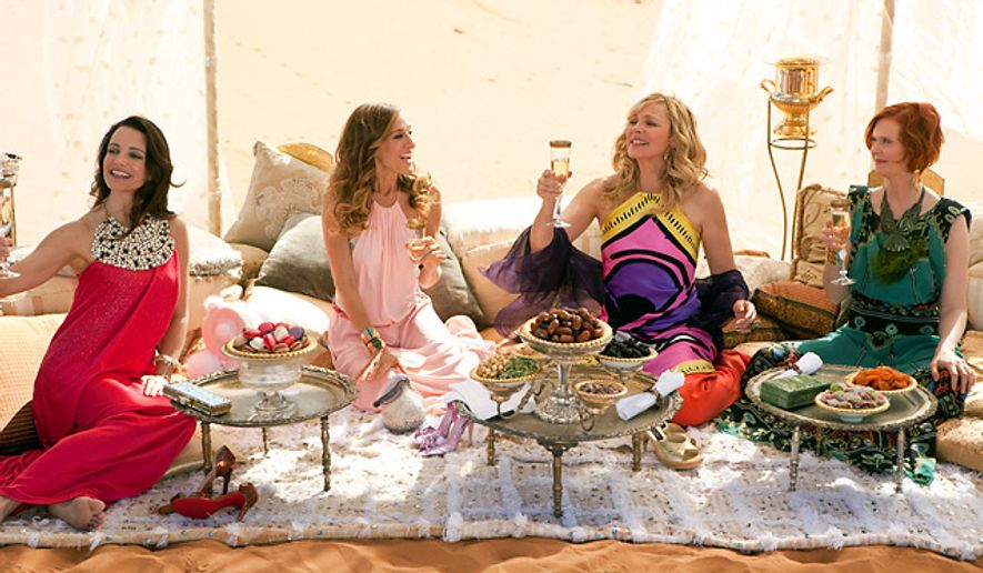 """From left, Kristin Davis, Sarah Jessica Parker, Kim Cattrall and Cynthia Nixon are shown in a scene from """"Sex and the City 2."""" The women of """"Sex and the City"""" and, now, its sequel, wear a fashion confidence like few others. (AP Photo/Warner Bros, Craig Blankenhorn)"""