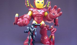 Hasbro's Rocket Boost Iron Man stands behind 3-3/4 inch versions of War Machine and Mark V Iron Man. (Photograph by Jacquie Kubin / Special to The Washington Times)