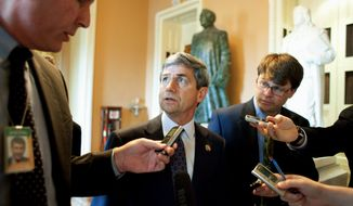 """ASSOCIATED PRESS Rep. Joe Sestak talks to reporters on Capitol Hill on Tuesday. Mr. Sestak, a former Navy admiral, made the assertion about a """"high-ranking"""" job offer at least twice - once to a local cable television interviewer Feb. 18 and again after his primary win on Sunday. He has steadfastly declined to say who approached him and which job was discussed."""