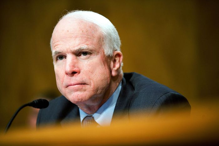 Sen. John McCain, seen at a May 17 Senate hearing, disagreed Thursday with objections to boosting a program that jails illegal immigrants briefly rather than immediately releasing them across the border. (Associated Press)
