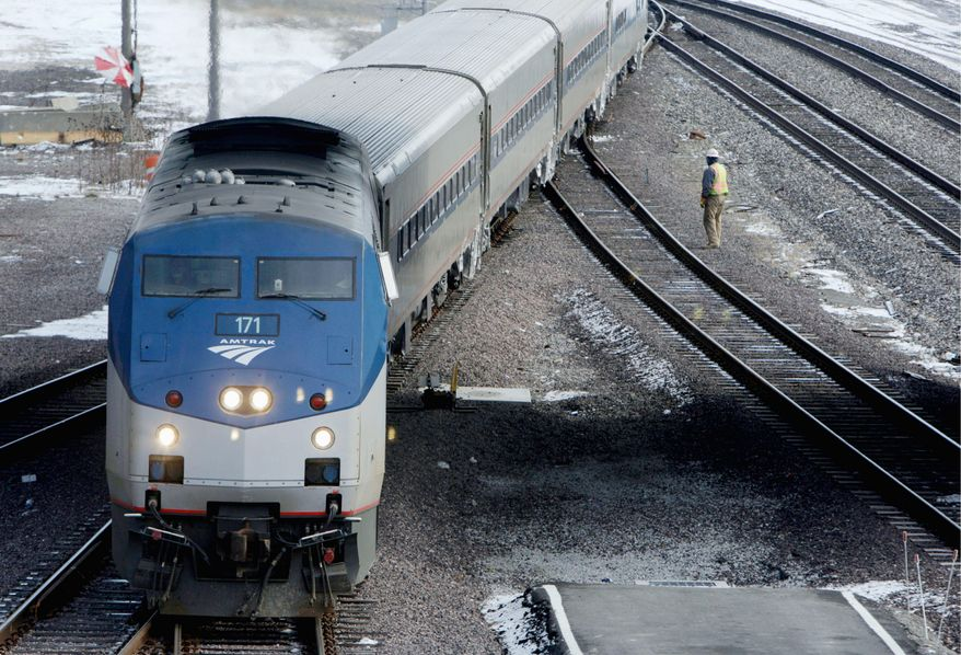 ** FILE ** An Amtrak train switches tracks in St. Louis after arriving from Chicago in 2010.  (Associated Press)