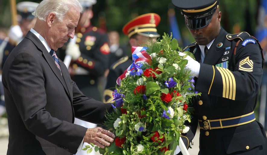 Vice President Joseph R. Biden Jr. lays a wreath at the Tomb of the Unknowns during Memorial Day ceremonies at Arlington National Cemetery on Monday, May 31, 2010. (AP Photo/Charles Dharapak)