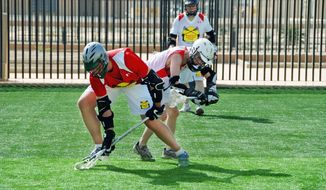 Diplomatic, military and contractor personnel in Baghdad last year formed the Baghdad Lacrosse Club, with the help of U.S. Ambassador to Iraq Christopher Hill (background). (U.S. Embassy in Baghdad)