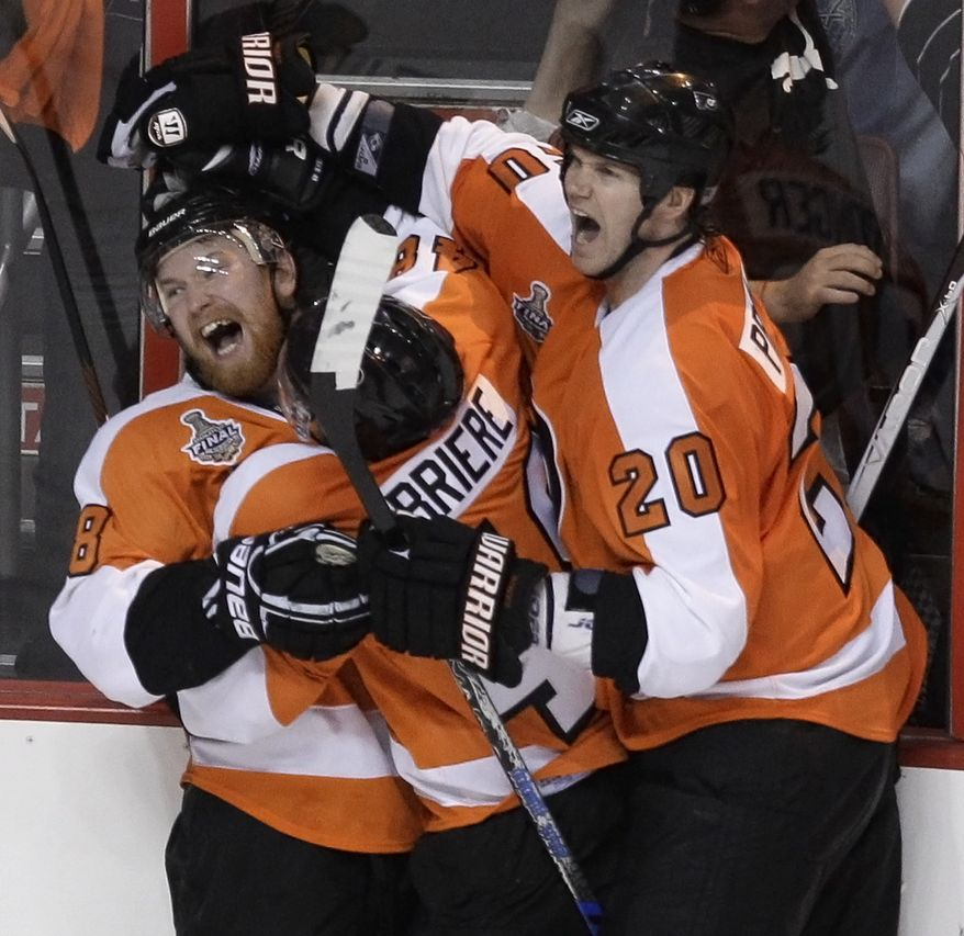 Philadelphia Flyers right wing Claude Giroux (left) celebrates with Danny Briere (center) and Chris Pronger after Giroux scored the game-winning goal against the Chicago Blackhawks in overtime of Game 3 of the Stanley Cup finals June 2, 2010, in Philadelphia. The Flyers won 4-3. The Blackhawks lead the series 2-1. (Associated Press)