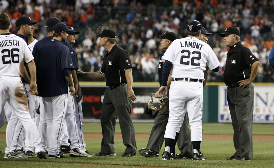 ASSOCIATED PRESS First base umpire Jim Joyce, right, talks with Detroit Tigers manager Jim Leyland (partially obscured) and coach Gene Lamont (22) as second base umpire Jim Wolf, center, keeps Tigers players back after a baseball game against the Cleveland Indians in Detroit, Wednesday, June 2, 2010. Tigers' Armando Galarraga lost his bid for a perfect game with two outs in the ninth inning on a disputed call at first base. Detroit won 3-0.