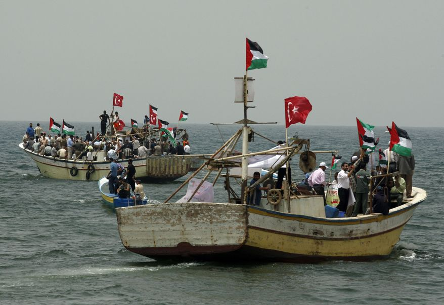 **FILE** Palestinians in fishing boats decorated with Turkish and Palestinian flags hold a pro-Turkey demonstration in the sea off the shore of Gaza City on June 3, 2010. Israel on Thursday rejected calls from the United Nations and others for an international investigation of its deadly raid on a Gaza-bound aid flotilla but left the door open to foreign involvement. (Associated Press)