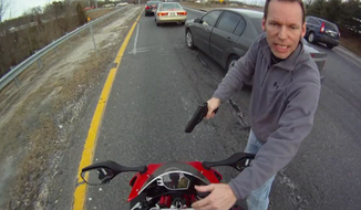 Screen capture from YouTube video of motorcyclist Anthony Graber's arrest.