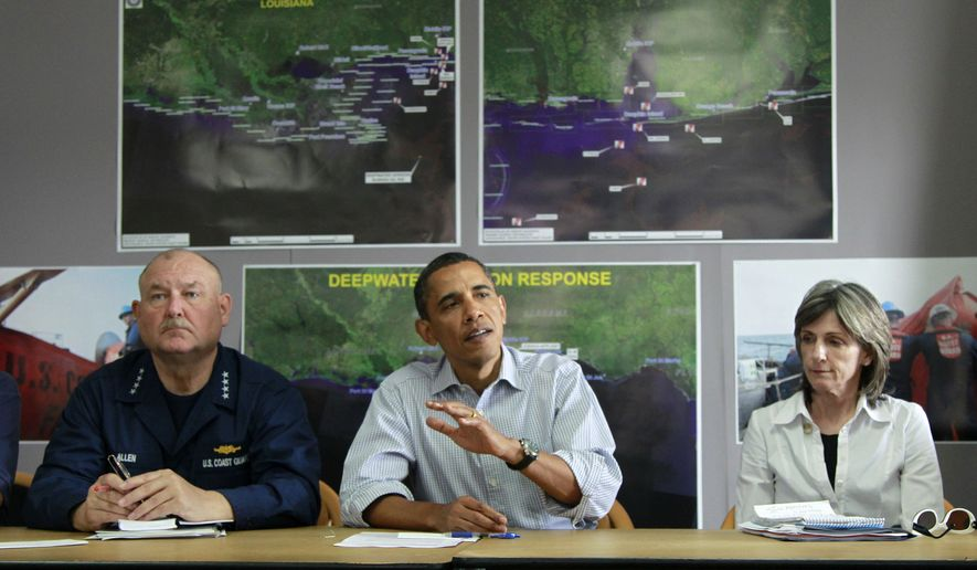 President Barack Obama, flanked by by National Incident Commander Adm. Thad Allen, left, and White House climate and energy adviser Carol Browner, makes a statement after being briefed on the BP oil spill relief efforts in the Gulf Coast region, Friday, June 4, 2010, at Louis Armstrong International New Orleans Airport in Kenner, La. (AP Photo/Charles Dharapak)