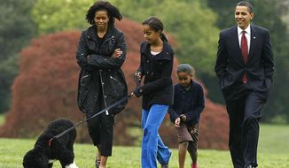 ** FILE ** Malia Obama walks with their new dog Bo as President Obama, first lady Michelle Obama and Sasha follow on the South Lawn of the White House in Washington, Tuesday, April 14, 2009. (AP Photo/Gerald Herbert)