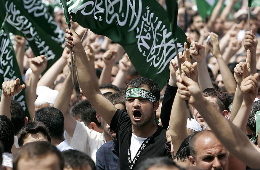 People shout religious slogans during the funeral of a victim of the Israeli naval commandos raid at the Beyazit mosque in Istanbul, Turkey, Friday, June 4, 2010, following the deadly raid which killed nine aboard the Gaza-bound flotilla. Israel insisted Friday that it won't let any aid ship breach its blockade of the Gaza Strip. (AP Photo/Ibrahim Usta)
