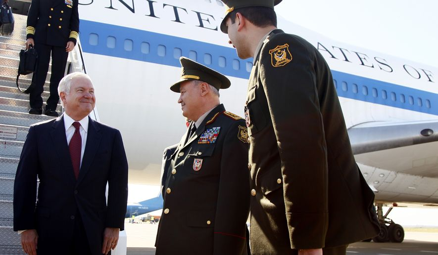 Defense Secretary Robert M. Gates (left) stands with Azerbaijan's minister of defense, Gen.-Col. Safar Abiyev (center), on the tarmac after Mr. Gates' arrival at the Heydar Aliyev International Airport in Baku, Azerbaijan, on Sunday, June 6, 2010. (AP Photo/Carolyn Kaster, Pool)