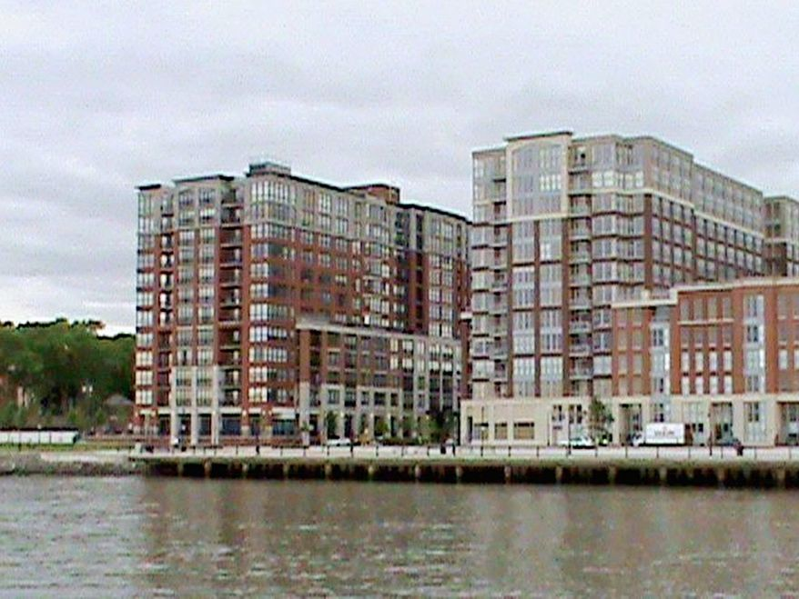 Luxury condominiums in Hoboken, N.J., offer a view of the New York skyline from the Maxwell Place development. Developers agreed to build a multimillion-dollar walkway and park, but later Congress approved millions of dollars in federal earmark funds to reduce the developers' obligation, records show. (Jim McElhatton/The Washington Times)