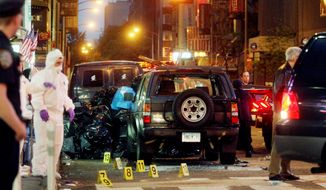 ** FILE ** Authorities examine a vehicle in New York's Times Square on May 2, 2010, after a bomb plot failed there. (AP Photo)