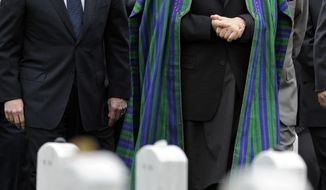 ** FILE ** Afghan President Hamid Karzai, right, tours Section 60 at Arlington National Cemetery with Secretary of Defense Robert Gates, left, and Army General Stanley McChrystal, Commander, International Security Assistance Force and Commander, U.S. Forces Afghanistan, in Washington, Thursday, May 13, 2010. (AP Photo/Cliff Owen)