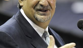 ASSOCIATED PRESS New Washington Wizards basketball team owner Ted Leonsis gestures during a news conference at the Verizon Center in Washington, Thursday, June 10, 2010. Earlier this week, the NBA Board of Governors unanimously approved the sale of the Washington Wizards to Leonsis.