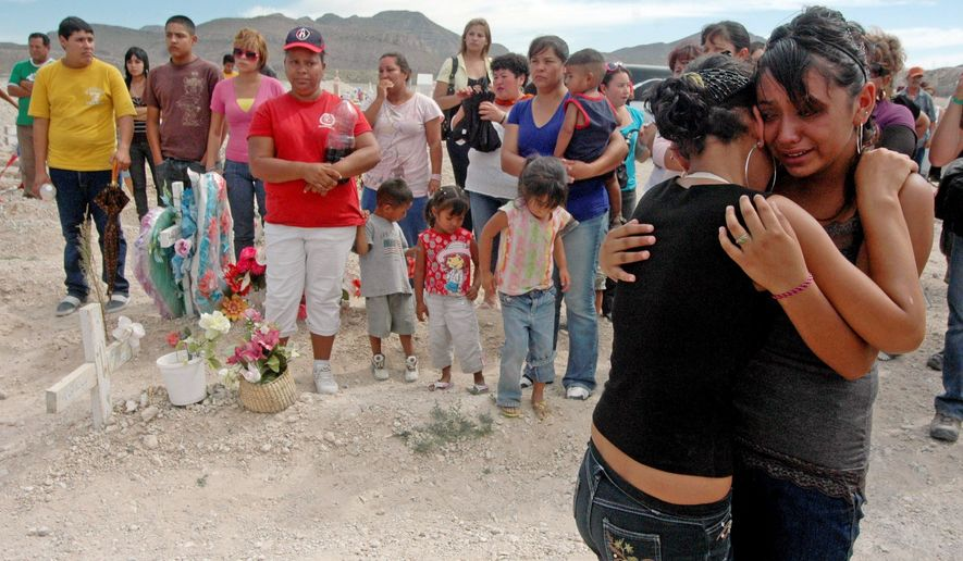 Mourners comfort each other Thursday during the funeral Thursday of Sergio, who was among a group attempting to gain entry to the United States when he was shot. (Associated Press)