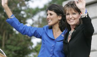 ** FILE ** Former Alaska Gov. Sarah Palin (right) waves to supporters after she endorses South Carolina state Rep. Nikki Haley (left) in the GOP gubernatorial primary race during a campaign rally at the Statehouse in Columbia, S.C., on May 14, 2010. (AP Photo/Mary Ann Chastain, File)