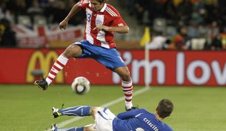 ASSOCIATED PRESS Paraguay's Enrique Vera, top, fights for the ball with Italy's Domenico Criscito during the World Cup group F soccer match between Italy and Paraguay in Cape Town, South Africa, Monday, June 14, 2010.