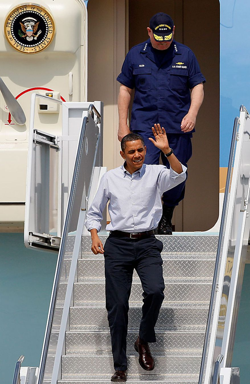 President Obama, followed by U.S. Coast Guard Adm. Thad Allen, the national incident commander, waves as he arrives at Gulfport-Biloxi International Airport in Gulfport, Miss., on Monday, June 14, 2010. This is Mr. Obama's fourth trip to the Gulf Coast since April's Deepwater Horizon oil rig explosion and oil spill in the Gulf of Mexico. (AP Photo/Patrick Semansky)