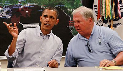 President Obama meets with Mississippi Gov. Haley Barbour regarding the BP Deepwater Horizon oil spill on Monday, June 14, 2010, at the U.S. Coast Guard Station in Gulfport, Miss. (AP Photo/Charles Dharapak)