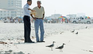 Associated Press President Obama and Florida Gov. Charlie Crist walk along the beach in Pensacola Beach, Fla., on Tuesday, assessing the risk of damage from the Gulf of Mexico oil spill. The two-day fact-finding trip also took him to Alabama and Mississippi.