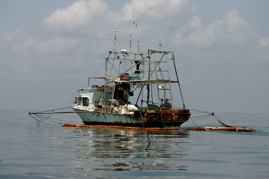 A vessel skims for oil near Queen Bess Island off the coast of Louisiana on Monday, June 14, 2010. Oil from the Deepwater Horizon spill continues to affect areas across the Gulf Coast. (AP Photo/Derick E. Hingle)