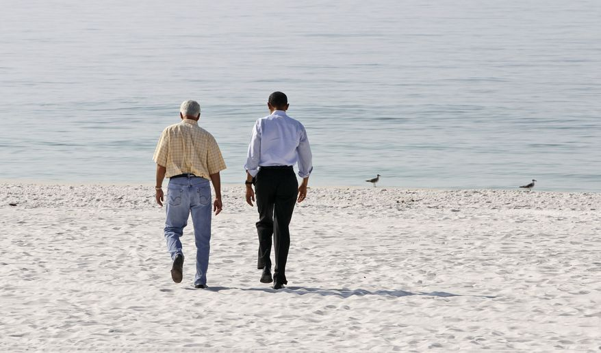 President Obama (right) and Florida Gov. Charlie Crist walk along Casino Beach on Pensacola Beach, Fla., on Tuesday, June 15, 2010, as Mr. Obama visited the Gulf Coast region affected by the BP Deepwater Horizon oil spill. (AP Photo/Charles Dharapak)