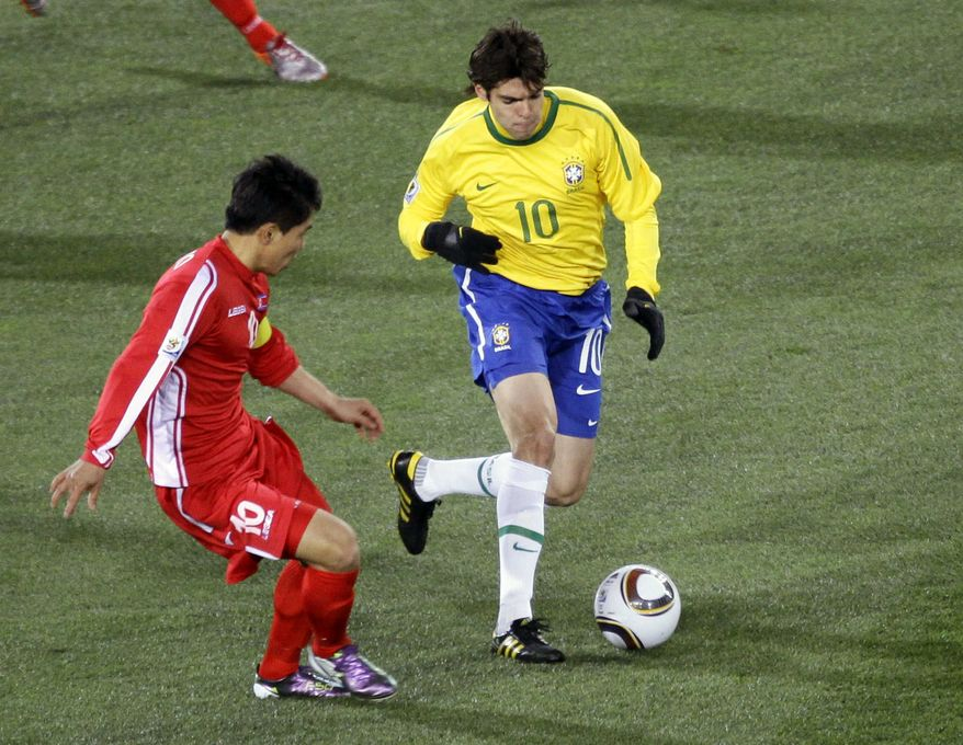 ASSOCIATED PRESS Brazil's Kaka, right, controls the ball next to North Korea's Hong Yong Jo during the World Cup group G soccer match between Brazil and North Korea at Ellis Park Stadium in Johannesburg, South Africa, Tuesday, June 15, 2010.