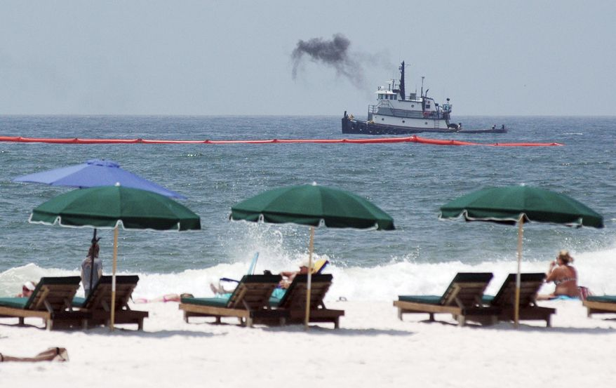 ** FILE ** This June 6, 2010, file photo shows beachgoers as a tugboat works to lay boom in the Gulf of Mexico near Perdido Pass at Orange Beach, Ala. Thousands of tourists will be changing vacation plans this summer because of the Gulf oil spill. (AP Photo/Jay Reeves, FILE)