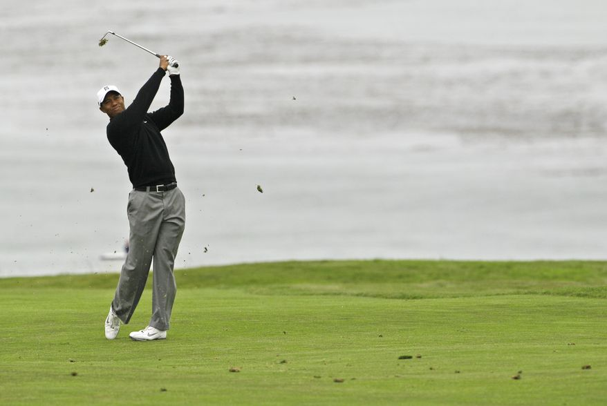 ASSOCIATED PRESS Tiger Woods hits a shot on the 11th hole during a practice round for the U.S. Open golf tournament Tuesday, June 15, 2010, at the Pebble Beach Golf Links in Pebble Beach, Calif.