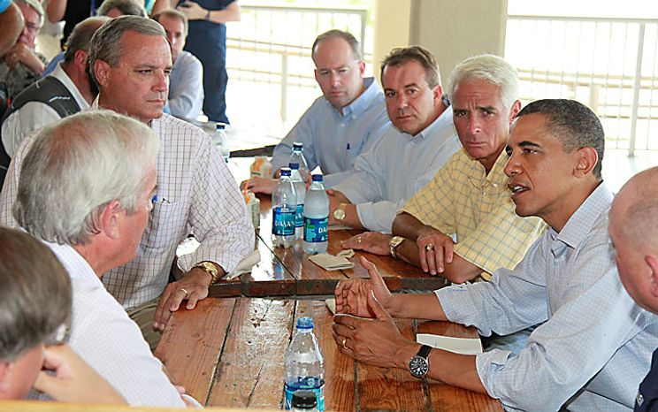 President Obama, flanked by Florida Gov. Charlie Crist, left, National Incident Commander Adm. Thad Allen, right, makes a statement on Pensacola Beach, Fla., Tuesday, June 15, 2010, as they visited the Gulf Coast region affected by the BP Deepwater Horizon oil spill. (AP Photo/Charles Dharapak)