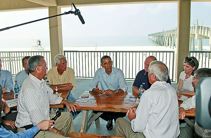 President Obama, accompanied by Florida Gov. Charlie Crist, left, and National Incident Commander Adm. Thad Allen, meets with  local officials on Pensacola Beach, Fla., Tuesday, June 15, 2010, as they visited the Gulf Coast region affected by the BP Deepwater Horizon oil spill. White House energy and climate adviser Carol Browner is at right. (AP Photo/Charles Dharapak)
