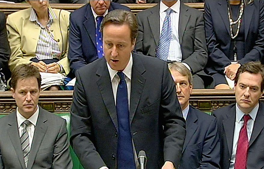 "Britain's Prime Minister David Cameron speaks in this image taken from TV in the Houses of Parliament in London Tuesday June 15, 2010 about Saville Inquiry into the Bloody Sunday killings in Londonderry Northern Ireland in 1972. Cameron  apologized on behalf of his country for the death  of 13 Catholic demonstrators in  Londonderry, an outrage that became known as ""Bloody Sunday.""  (AP Photo/PA)"