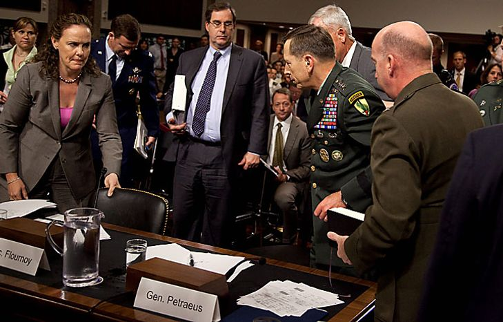Army Gen. David Petraeus, U.S. Central Commander, is led away by staff after appearing to collapse on Capitol Hill in Washington on Tuesday, June 15, 2010, while testifying before the Senate Armed Services Committee. (AP Photo/Evan Vucci)