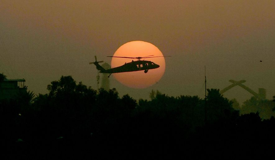 A U.S. Army Black Hawk helicopter flies as the sun sets in Baghdad. State has asked that 24 of the helicopters for the small army that will stay in Iraq to protect U.S. diplomatic personnel after military forces leave. (Associated Press)