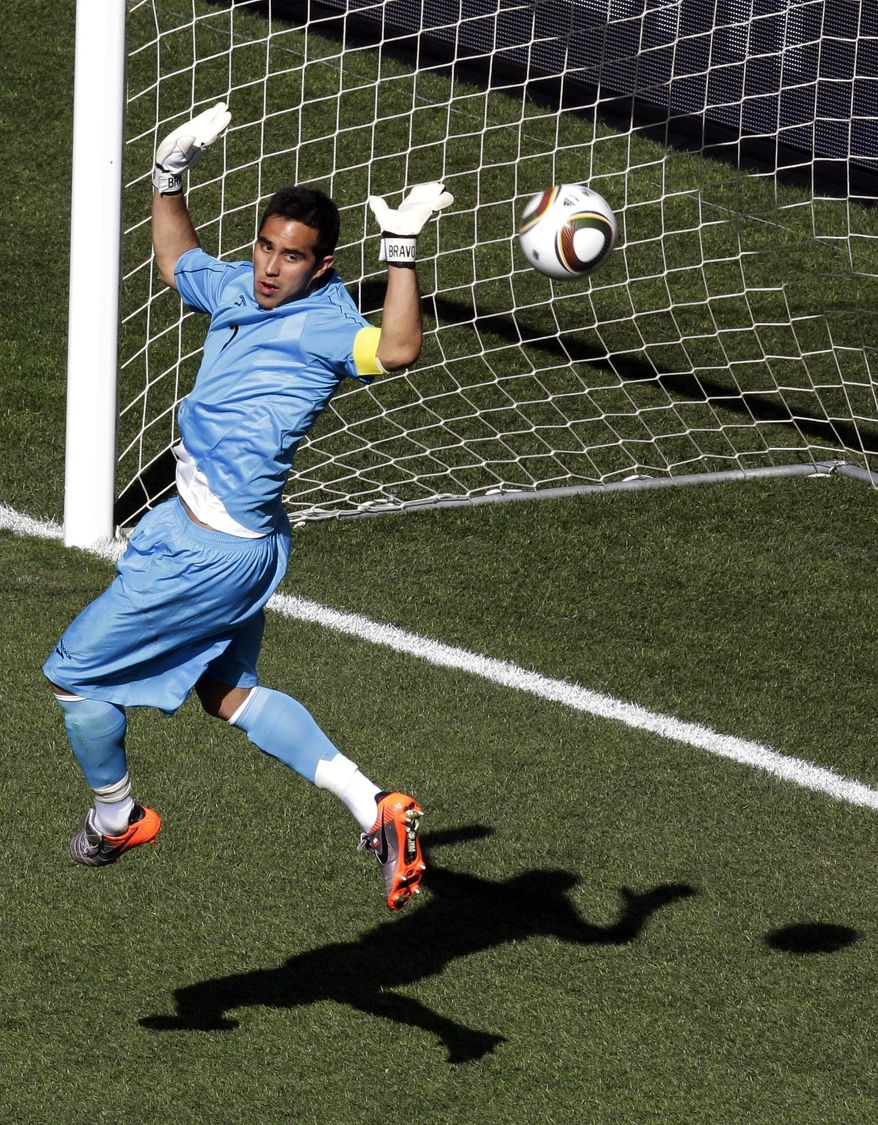 Chile goalkeeper Claudio Bravo looks at the ball during the World Cup group H soccer match between Honduras and Chile at Mbombela Stadium in Nelspruit, South Africa, Wednesday, June 16, 2010. (AP Photo/Michael Sohn)