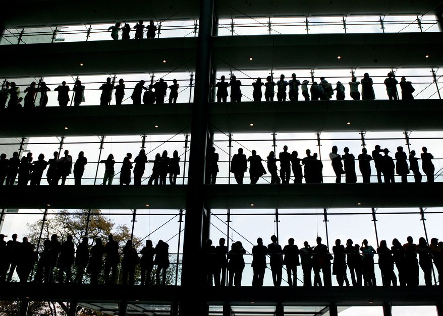 In this Oct. 30, 2007, file photo, employees are silhouetted at the Boehringer Ingelheim pharmaceutical factory in Ingelheim, central Germany. Boehringer Ingelheim has asked the Food and Drug Administration to approve its drug flibanserin for women who report a lack of sexual desire, a market that drugmakers have been targeting for more than a decade since the success of Viagra in men. Federal health regulators said Wednesday, June 16, 2010, the first pill designed to boost the female sex drive failed to make a significant impact on libido in two studies.(AP Photo/Michael Pobst, file)